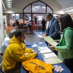 People visit a NAACP booth before a town hall meeting sponsored by Georgia Charter Schools Association and GeorgiaCAN at Ebenezer Baptist Church on Friday, Jan. 13, 2017, in Atlanta. (Branden Camp/AP Images for Georgia Charter Schools Association)