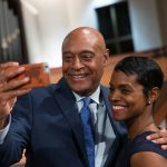Kevin Chavous, national education expert, and Rashan Ali take a selfie following a town hall meeting sponsored by Georgia Charter Schools Association and GeorgiaCAN at Ebenezer Baptist Church on Friday, Jan. 13, 2017, in Atlanta. (Branden Camp/AP Images for Georgia Charter Schools Association)