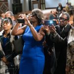 People take photos of the panelist following a town hall meeting sponsored by Georgia Charter Schools Association and GeorgiaCAN at Ebenezer Baptist Church on Friday, Jan. 13, 2017, in Atlanta. (Branden Camp/AP Images for Georgia Charter Schools Association)