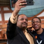 Journalist Roland S. Martin takes a photo with a man following a town hall meeting sponsored by Georgia Charter Schools Association and GeorgiaCAN at Ebenezer Baptist Church on Friday, Jan. 13, 2017, in Atlanta. (Branden Camp/AP Images for Georgia Charter Schools Association)
