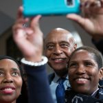 Kevin Chavous, national education expert, takes a photo with guest following a town hall meeting sponsored by Georgia Charter Schools Association and GeorgiaCAN at Ebenezer Baptist Church on Friday, Jan. 13, 2017, in Atlanta. (Branden Camp/AP Images for Georgia Charter Schools Association)