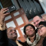 Journalist Roland S. Martin takes a photo with guest following a town hall meeting sponsored by Georgia Charter Schools Association and GeorgiaCAN at Ebenezer Baptist Church on Friday, Jan. 13, 2017, in Atlanta. (Branden Camp/AP Images for Georgia Charter Schools Association)