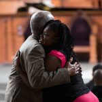 People embrace before a town hall meeting sponsored by Georgia Charter Schools Association and GeorgiaCAN at Ebenezer Baptist Church on Friday, Jan. 13, 2017, in Atlanta. (Branden Camp/AP Images for Georgia Charter Schools Association)